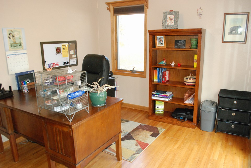 office on main floor w/ a kozy heat  firplace and walk-out to patio area