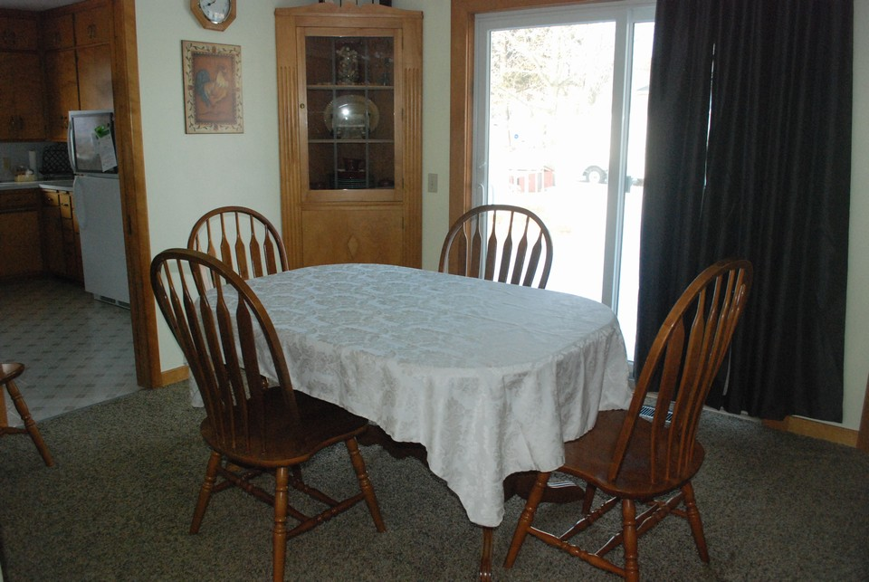 dining room with a new patio door to backyard.