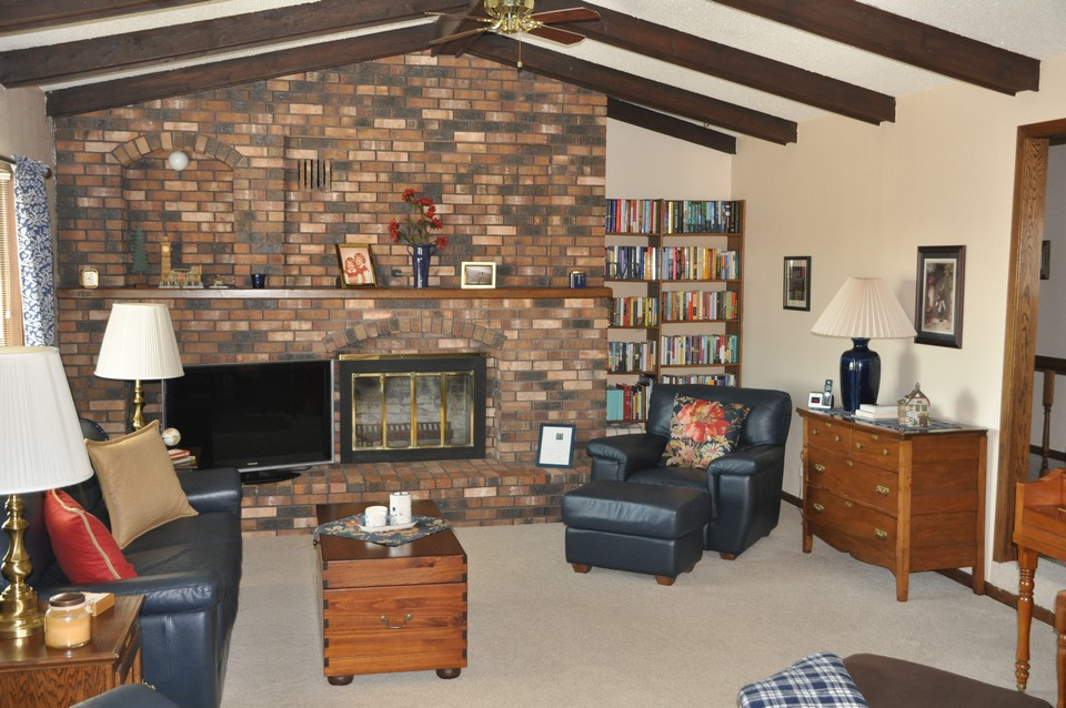 living room w/ fireplace-wood